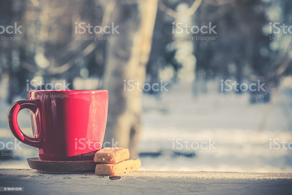 Red coffee tea mug cup with butter shortbread bisquits stock photo