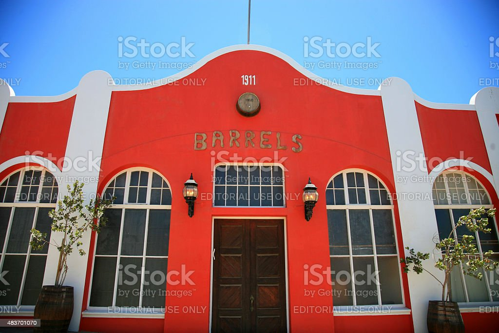 Red colonial house with a blue sky in Luderitz stock photo