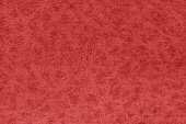 Red color leather surface.