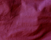 Red color textile cloth surface.