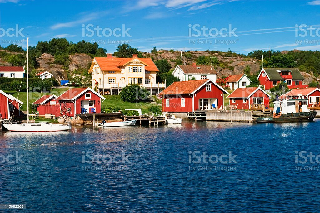 Red color wall summer house by the lake royalty-free stock photo