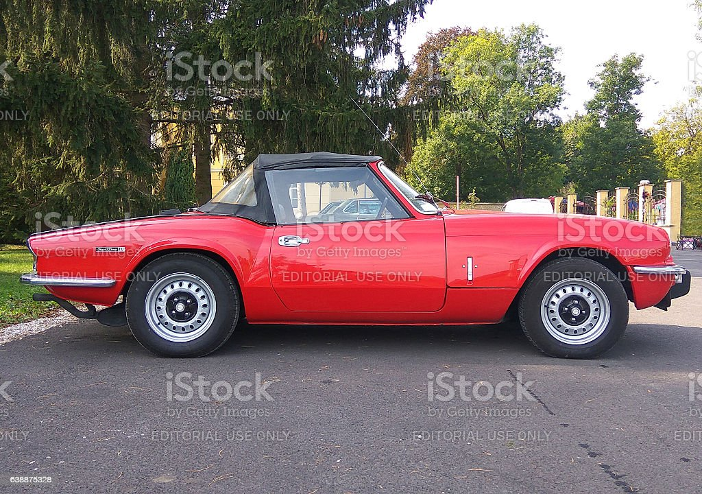 Red colored british six-cylinder sports car Triumph TR6 stock photo