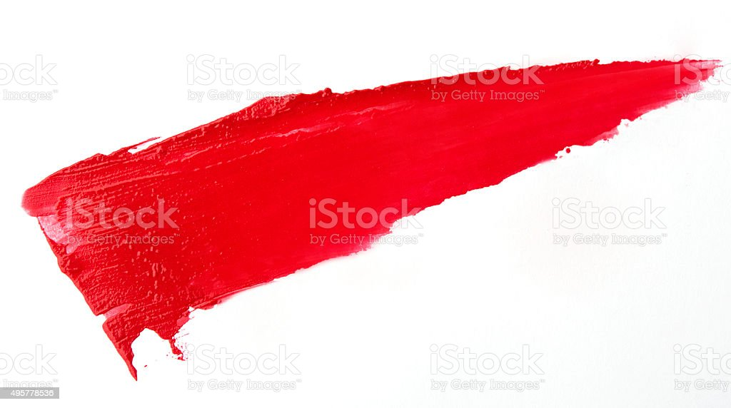 Red colour lipstick stroke on white paper stock photo