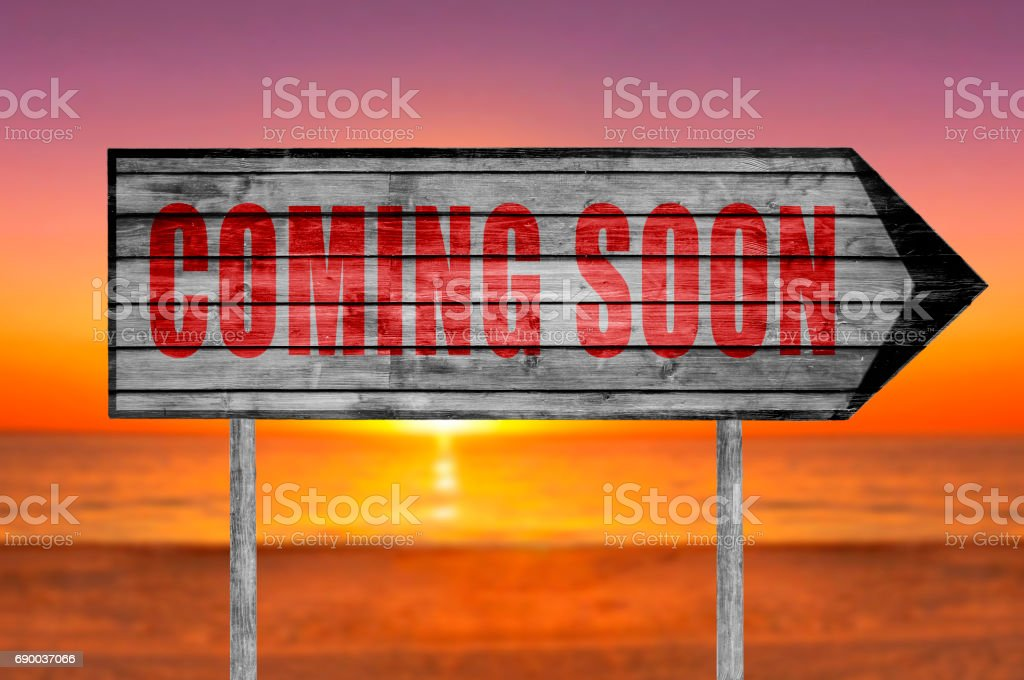 Red Coming Soon wooden sign isolated stock photo