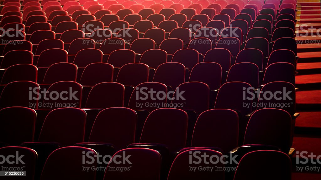 Red concert hall, opera or theatre seats. stock photo