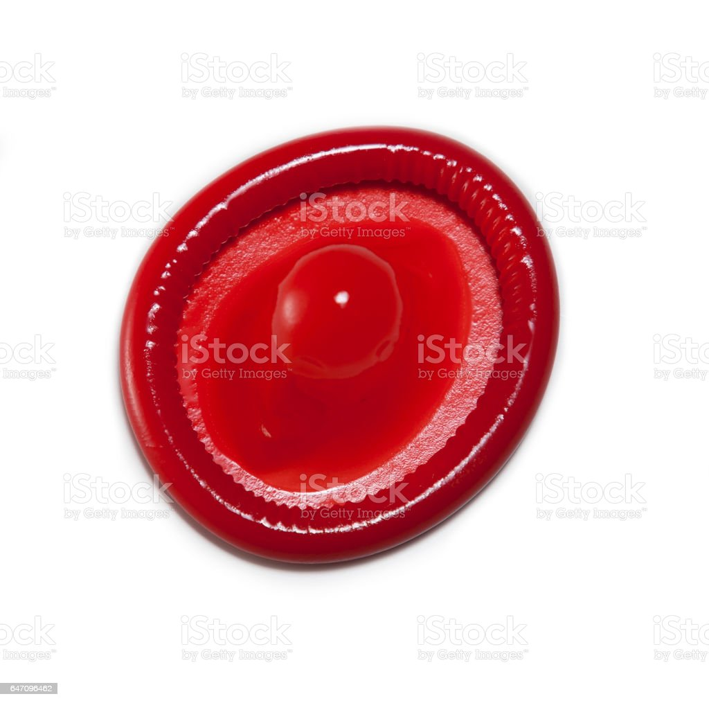 red condom isolated on white background stock photo