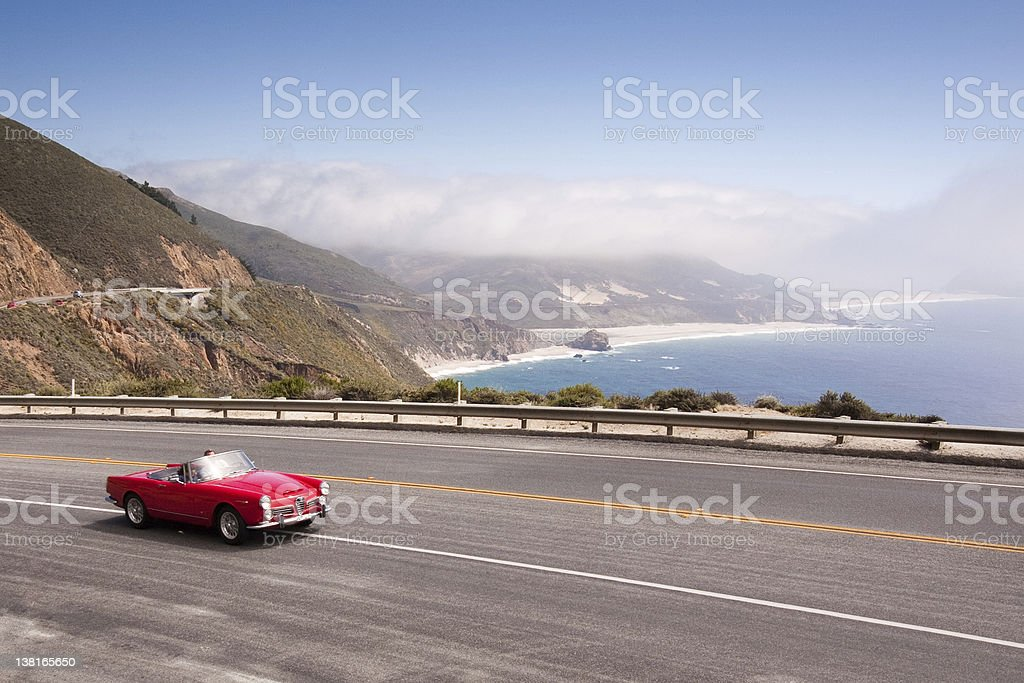 Red convertible on the coast stock photo