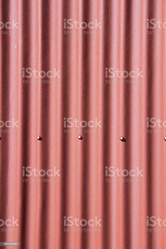 Red corrugated metal as a background image royalty-free stock photo
