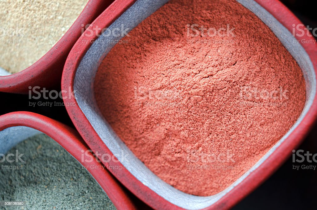 Red cosmetic clay powder stock photo