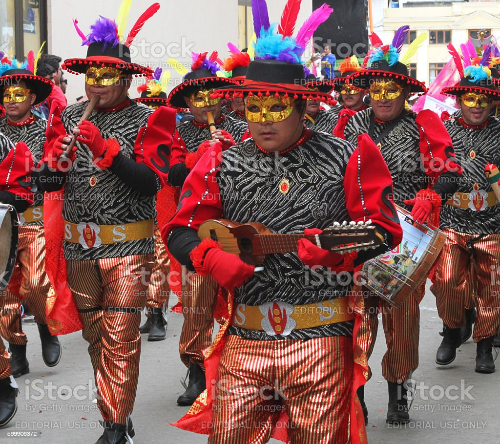 Red Costumed Band Plays in Carnival Parade stock photo