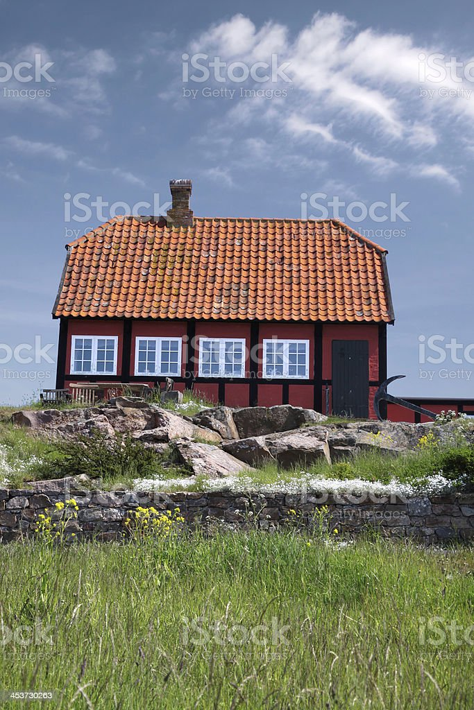 Red cottage house stock photo