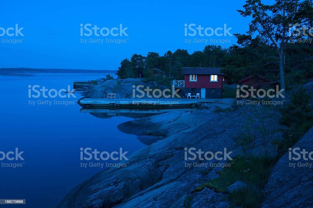 Red cottage in the archipelago just after sunset stock photo
