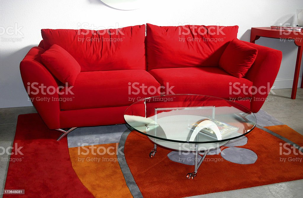 Red Couch and Glass Table royalty-free stock photo