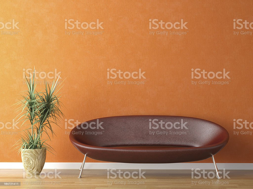 red couch on orange wall royalty-free stock photo