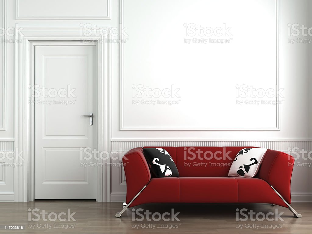 red couch on white interior wall stock photo