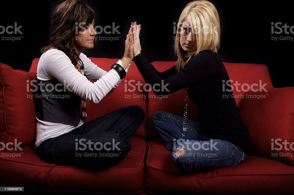 red couch young woman portraits stock photo