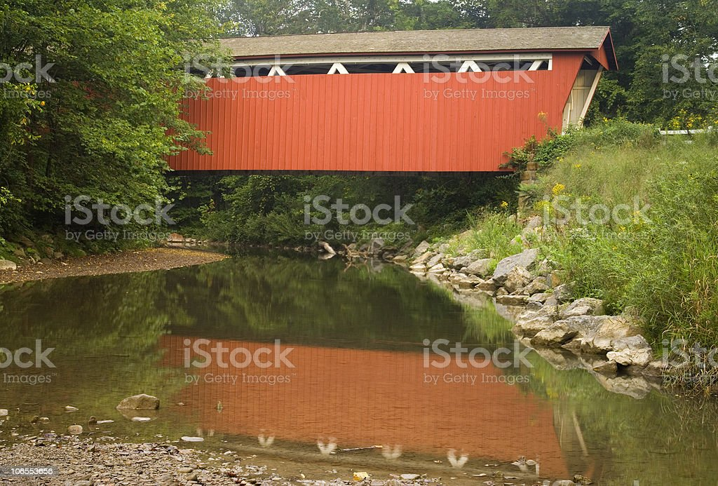 Red Covered Bridge Over a Stream stock photo