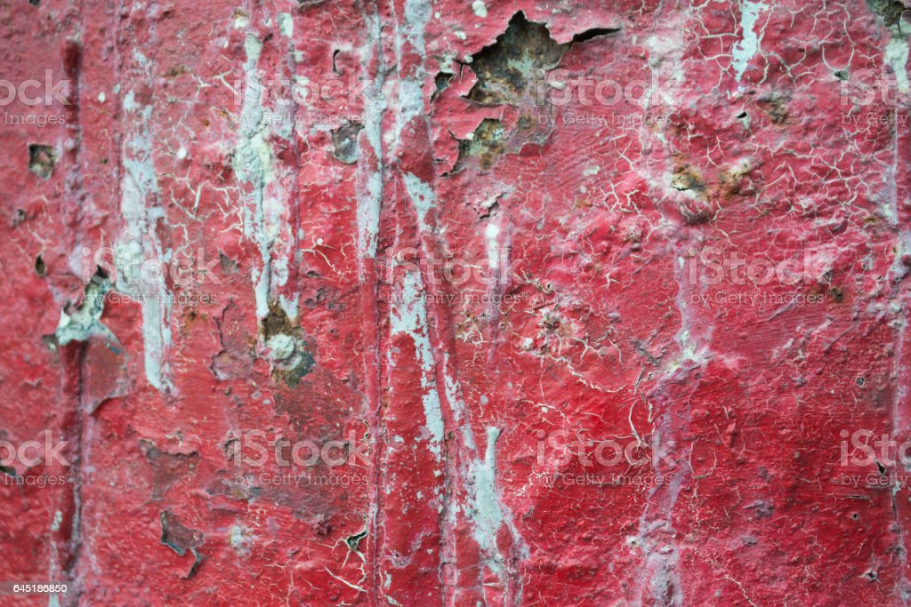 Red Cracked Paint on Wall stock photo
