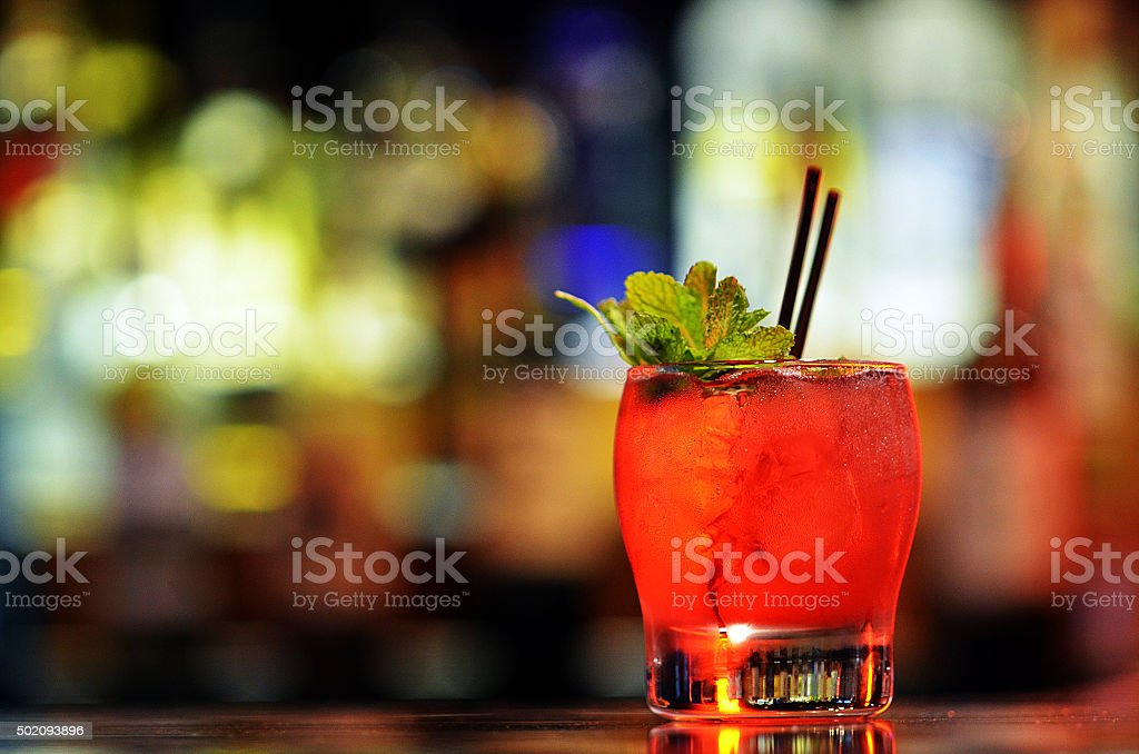 Red Craft Cocktail with Garnish on Bar stock photo