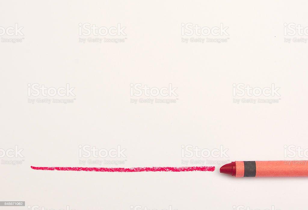 Red crayon drawing a line on white paper foto de stock libre de derechos