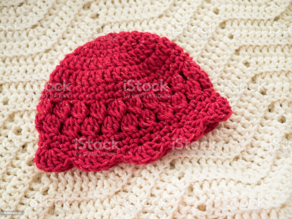 Red Crocheted Baby Cap stock photo