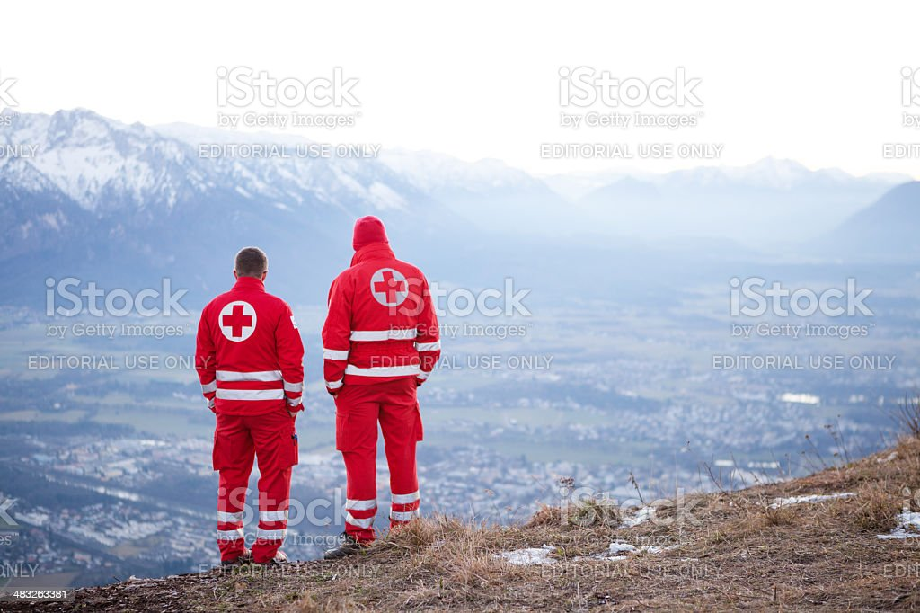 Red Cross helper in the Mountain stock photo