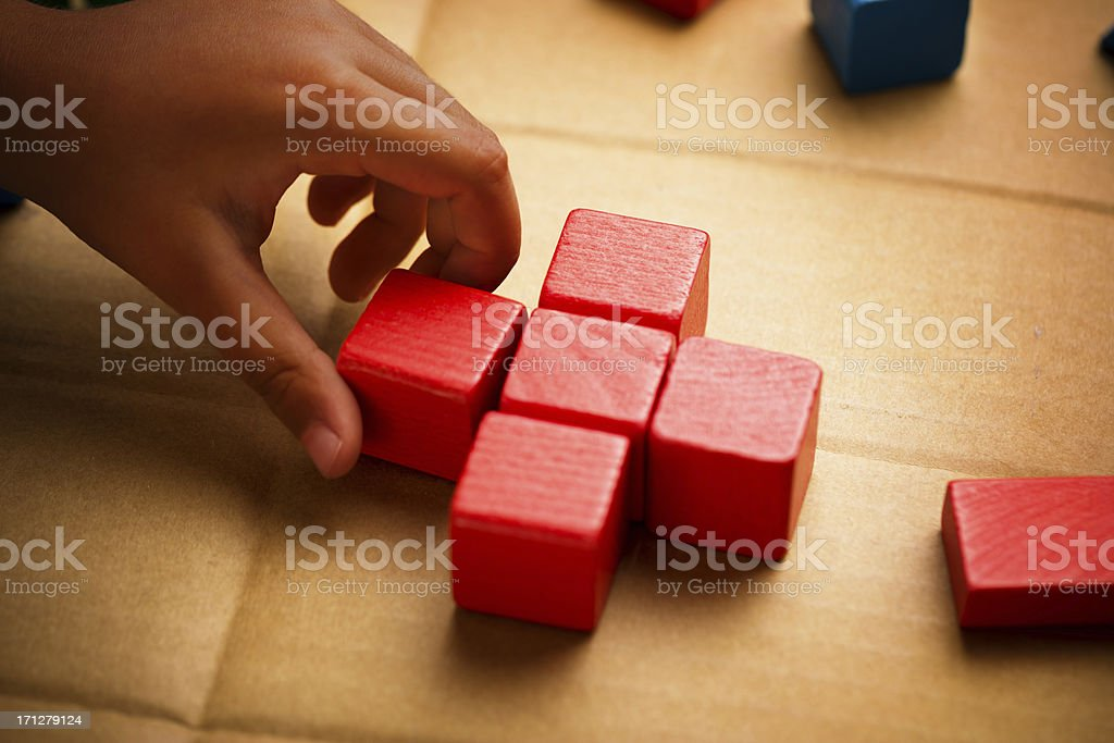 Red Cross made from wood blocks stock photo