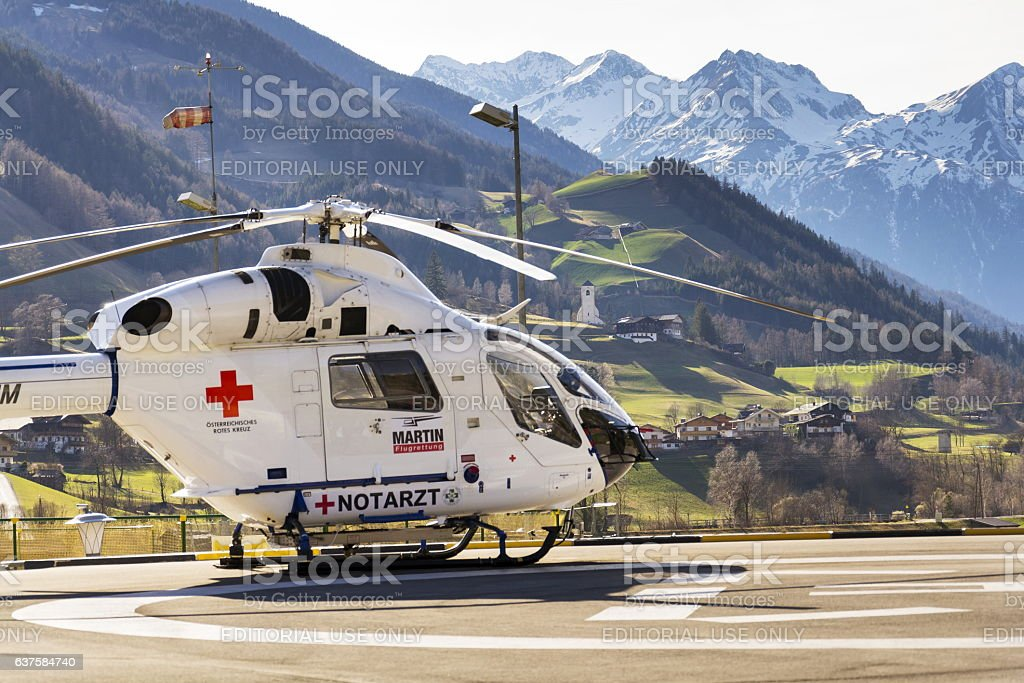 Red Cross medic MD Helicopter MD Explorer stands on heliport stock photo