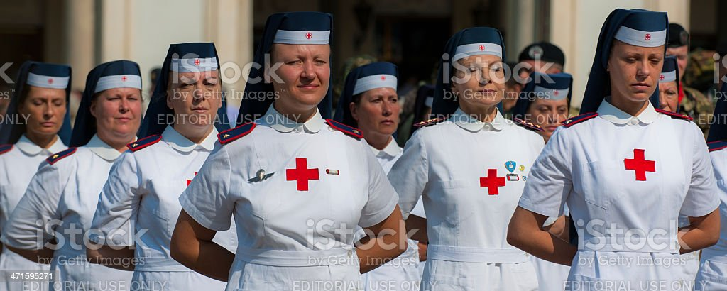 Red cross military nurses during an  ASSOARMA's meeting royalty-free stock photo