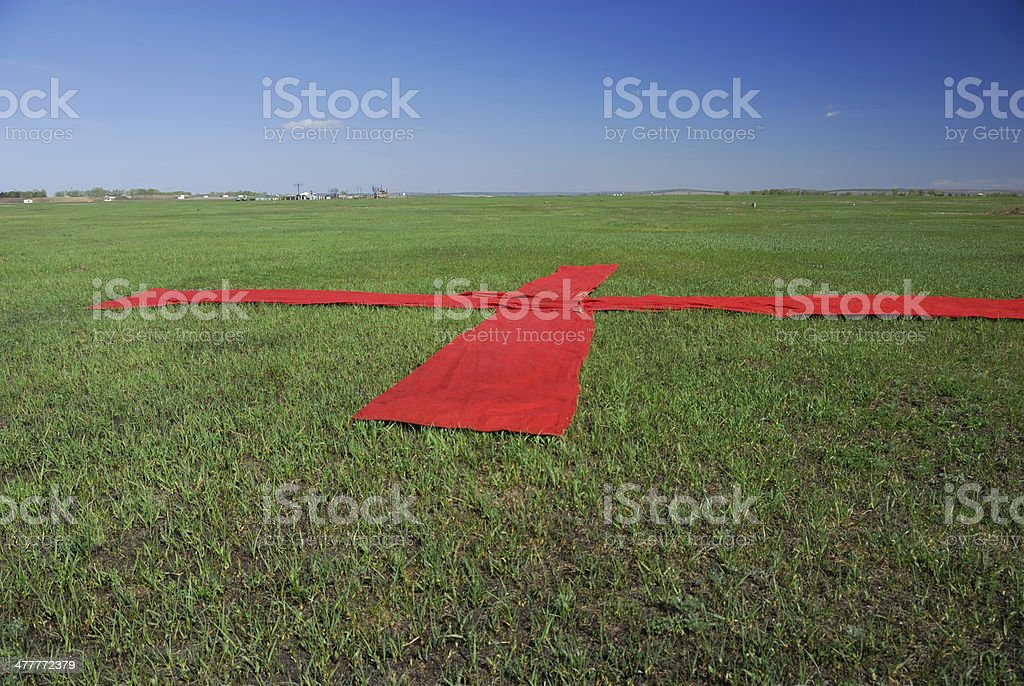Red cross on the grass royalty-free stock photo