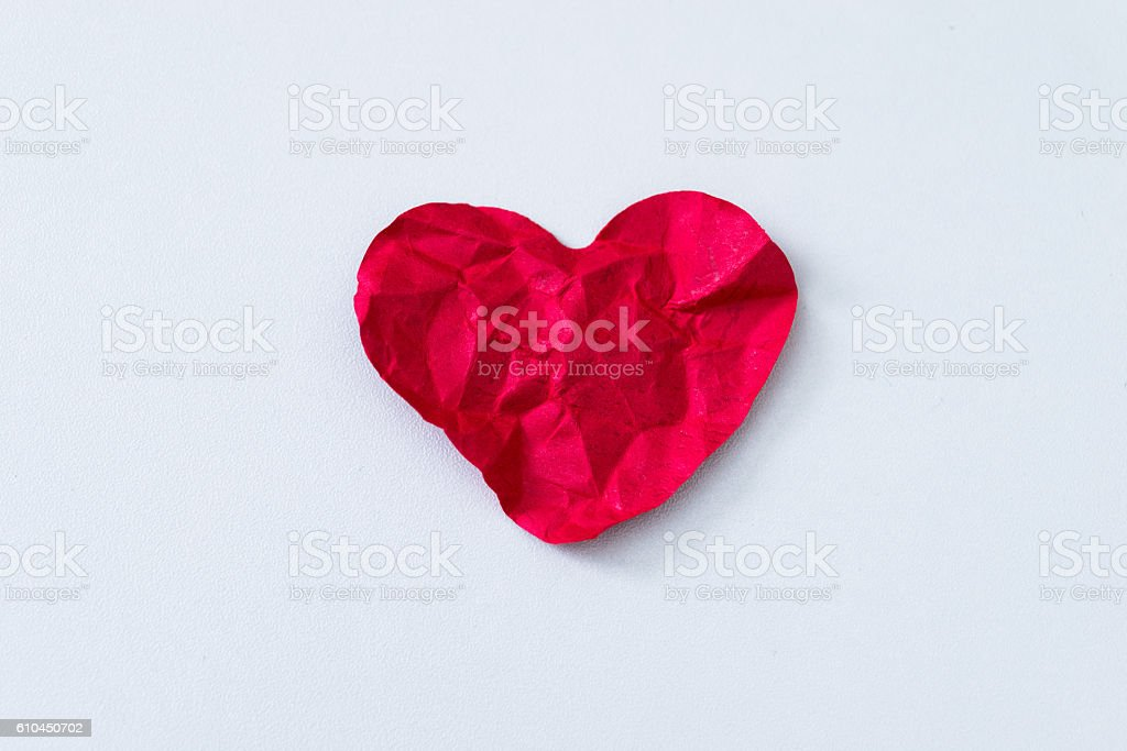 Red crumpled paper heart stock photo