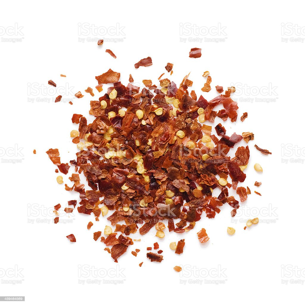 Red crushed chili peppers on seamless white background stock photo