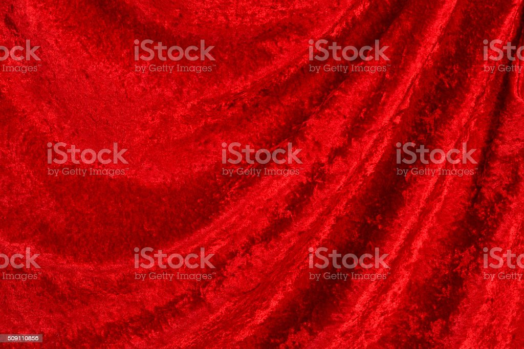 Red crushed velvet background with draped folds stock photo