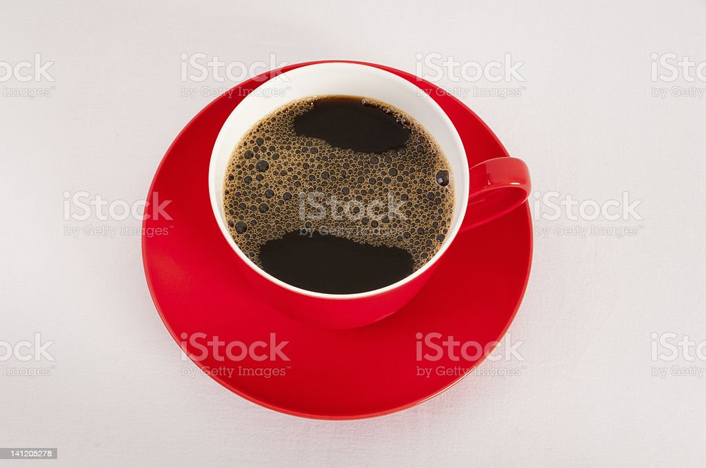 Red cup and saucer with black coffee royalty-free stock photo