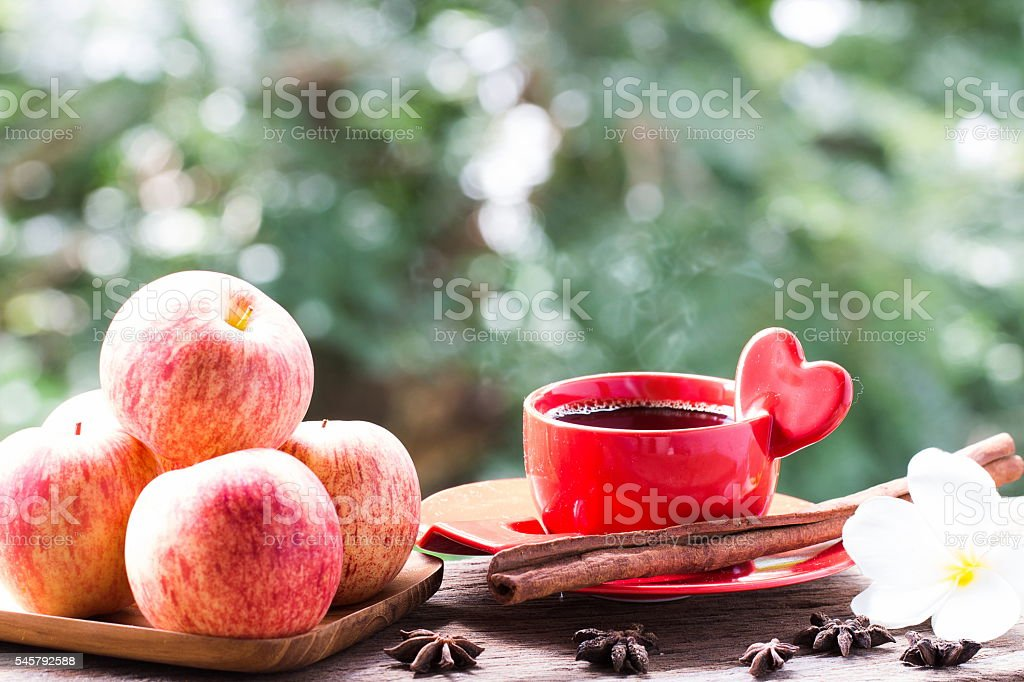 red cup of coffee on wooden, apple, Flower, cinnamon stock photo