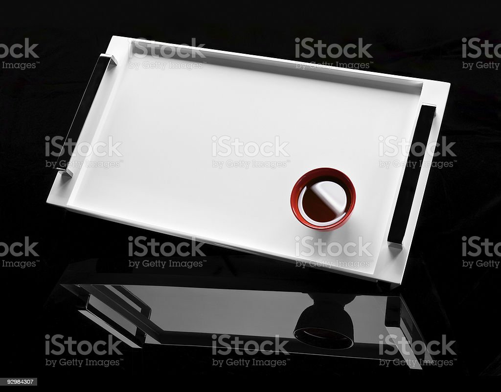 Red cup of tea on a white tray royalty-free stock photo
