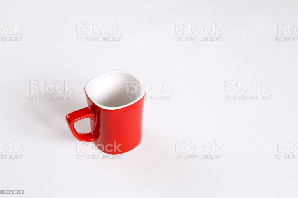 A red cup on a white background stock photo