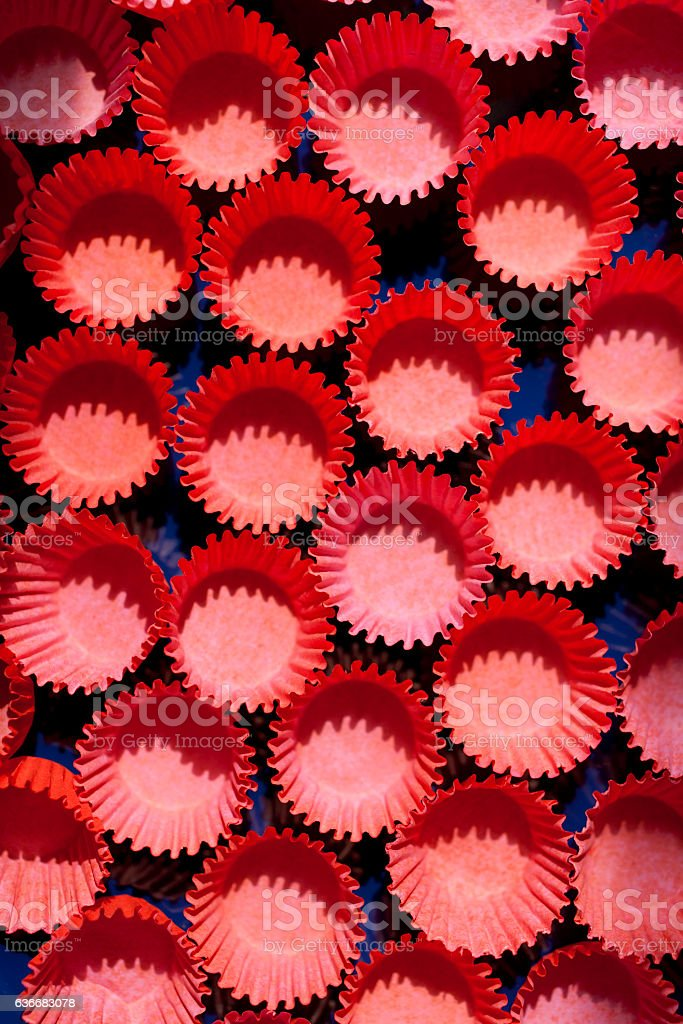 Red cupcake holders stock photo