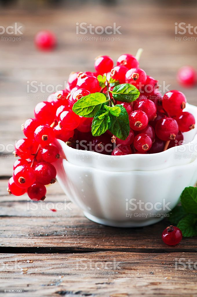 Red currant and mint on the wooden table stock photo
