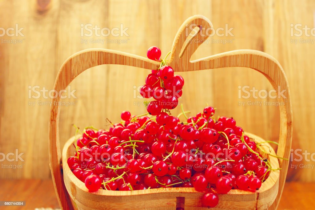 red currant on the wooden vase stock photo