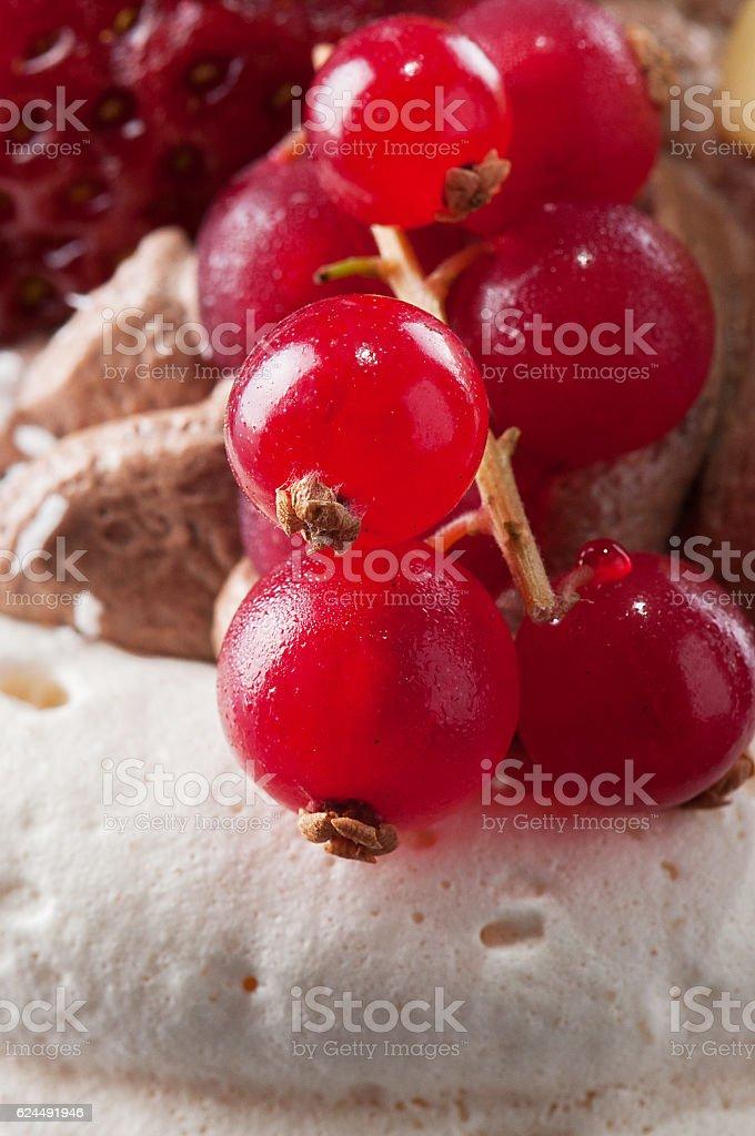 Red currants on meringue cake stock photo