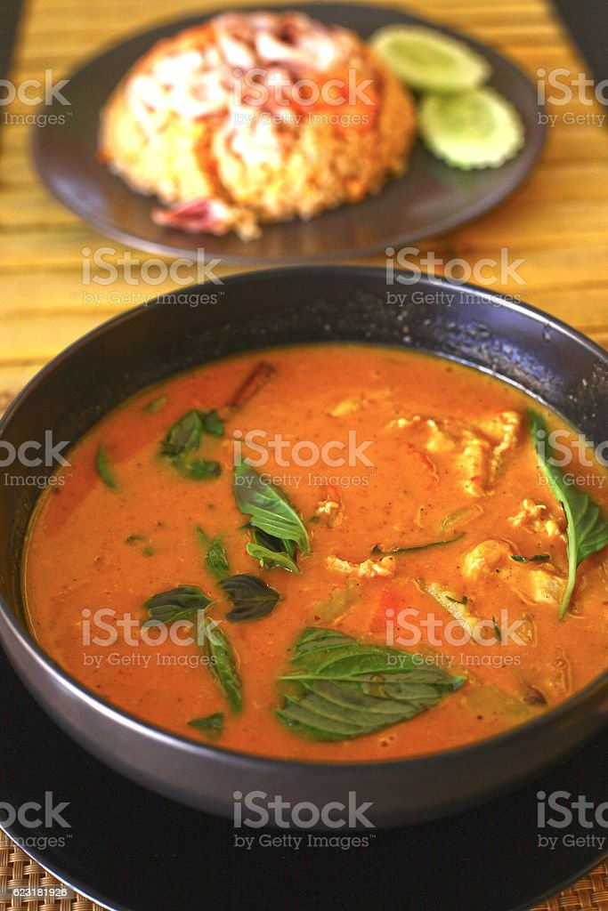 red curry asian thai soup with chicken stock photo