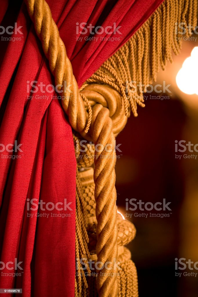 Red curtain with gold tassel stock photo