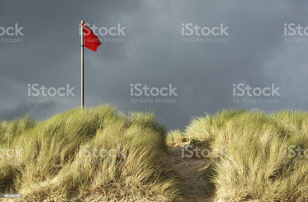 Red danger flag on a beach royalty-free stock photo