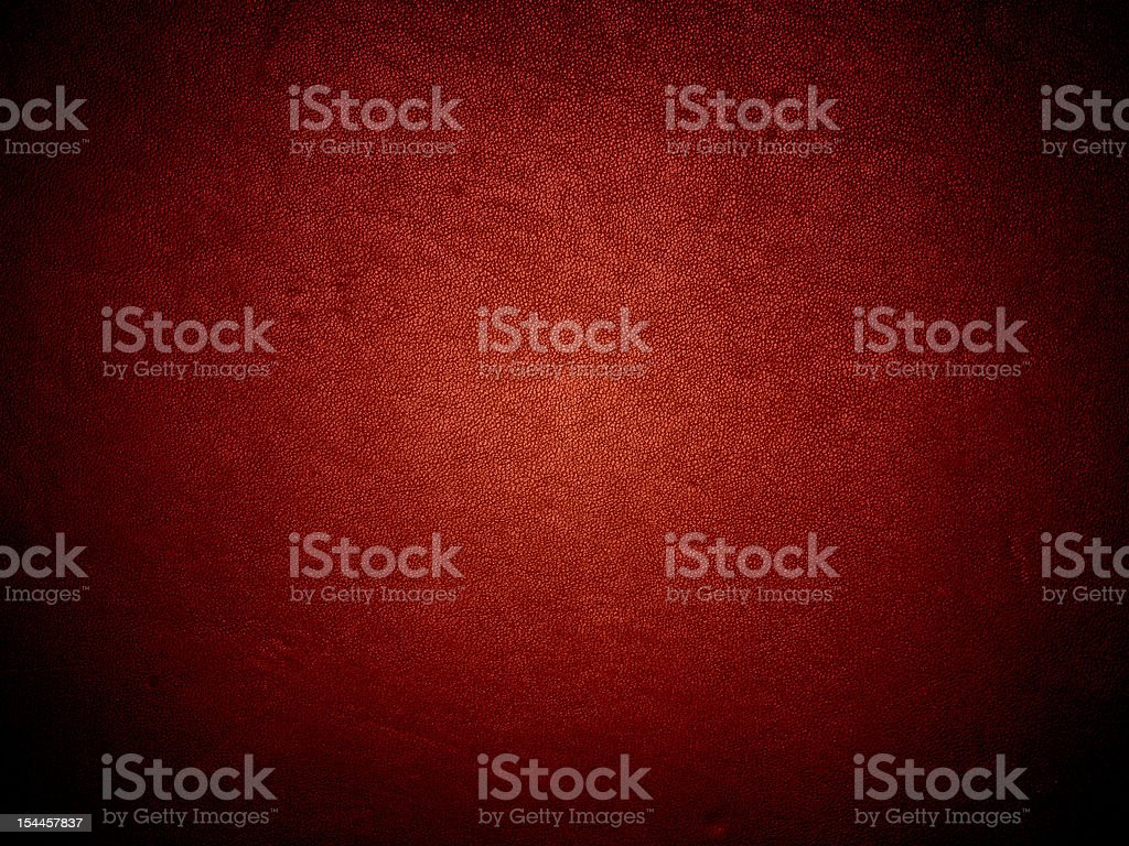 Red dark wall background illuminated by a light stock photo
