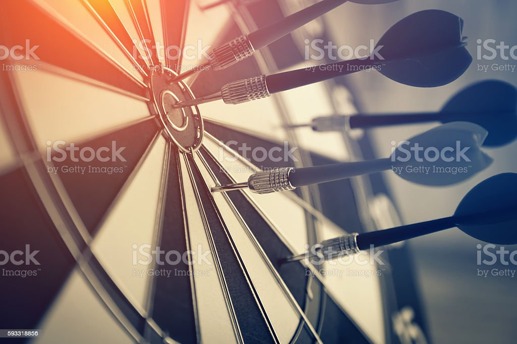 Red dart arrow hitting in the target stock photo