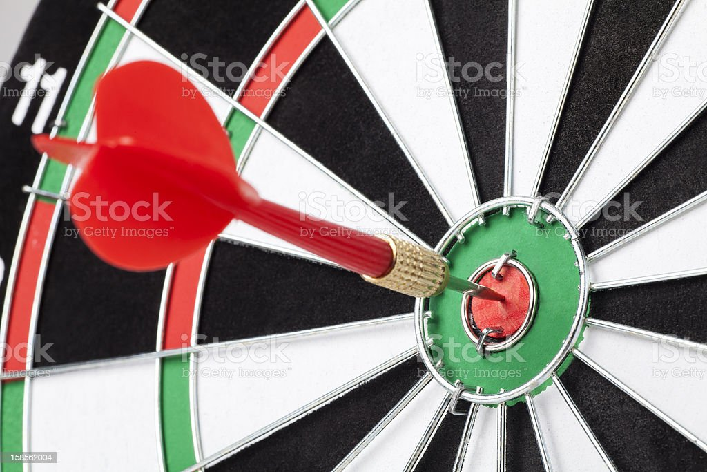 Red dart hitting a target royalty-free stock photo