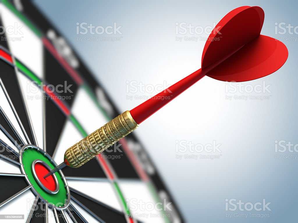 A red dart in a bulls eye target stock photo
