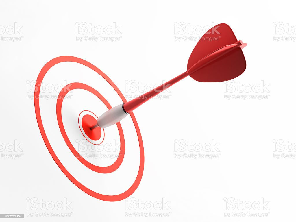 Red dart in red bullseye of target on a white background royalty-free stock photo