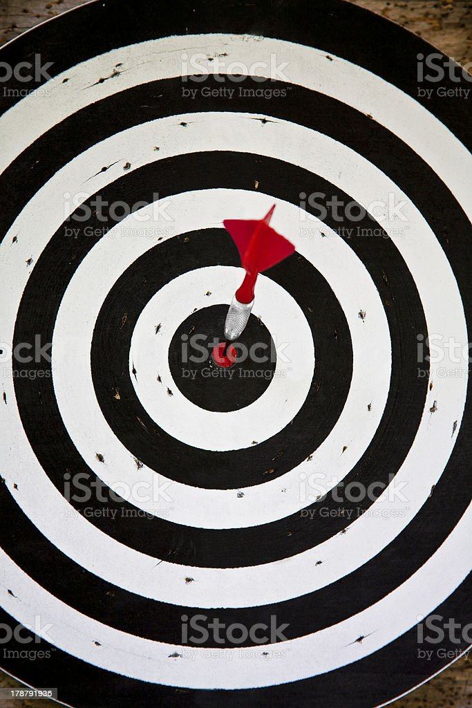 Red dart on black and white dartboard royalty-free stock photo